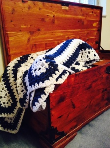 cedar chest, crocheted blanket blue and white